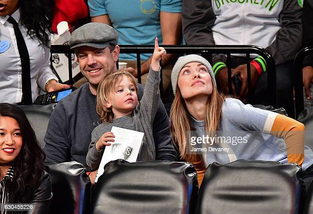 Jason Sudeikis Otis Sudeikis and Olivia Wilde attend Golden State Warriors Vs Brooklyn Nets game at Barclays Center on December 22 2016 in New York...
