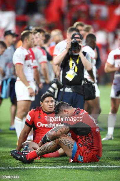 Jason Taumalolo and Andrew Fifita of Tonga are dejected following the 2017 Rugby League World Cup Semi Final match between Tonga and England at Mt...
