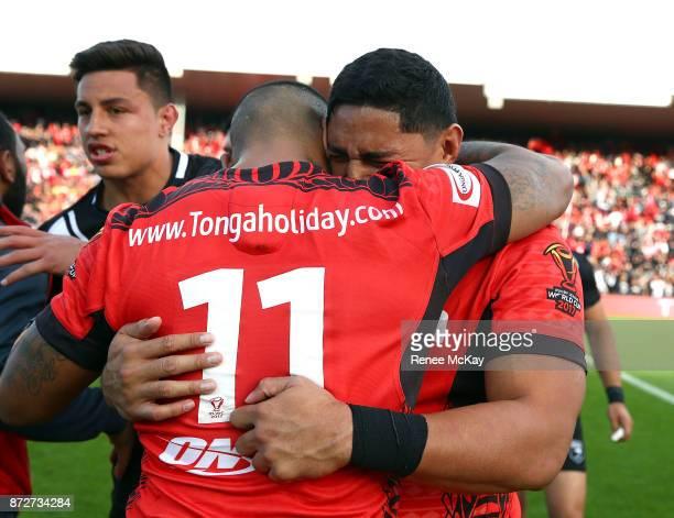 Jason Taumalolo hugs team mate Manu Ma'u during the 2017 Rugby League World Cup match between the New Zealand Kiwis and Tonga at Waikato Stadium on...