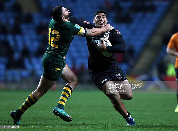 Jason Taumalolo of New Zealand Kiwis tackled by Matt Gillett of Australia Kangaroos during the Four Nations match between the New Zealand Kiwis and...