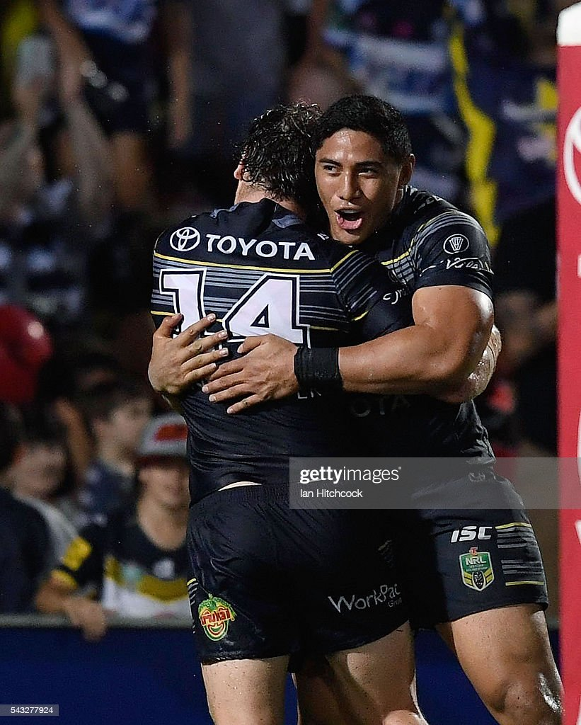 Jason Taumalolo (r) of the Cowboys celebrates after scoring a try during the round 16 NRL match between the North Queensland Cowboys and the Manly Sea Eagles at 1300SMILES Stadium on June 27, 2016 in Townsville, Australia.