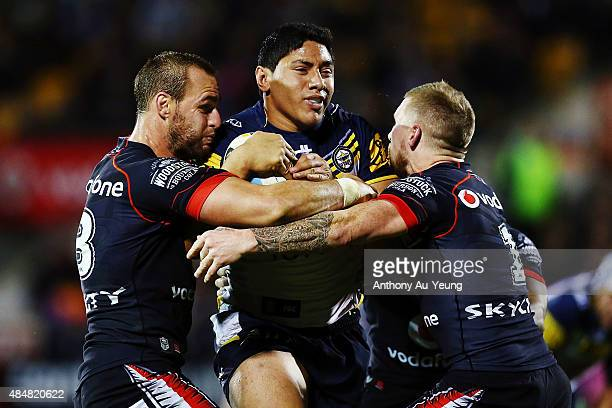 Jason Taumalolo of the Cowboys charges against Simon Mannering and Sam Tomkins of the Warriors during the round 24 NRL match between the New Zealand...