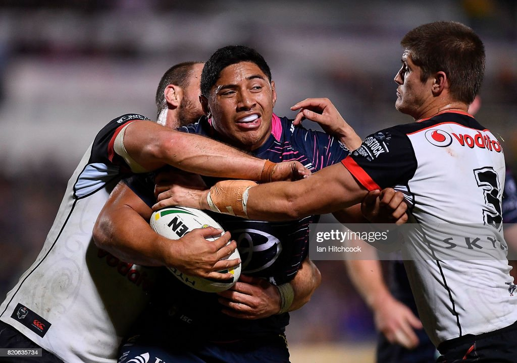 Jason Taumalolo of the Cowboys is tackled by Blake Ayshford and Simon Mannering of the Warriors during the round 20 NRL match between the North Queensland Cowboys and the New Zealand Warriors at 1300SMILES Stadium on July 22, 2017 in Townsville, Australia.
