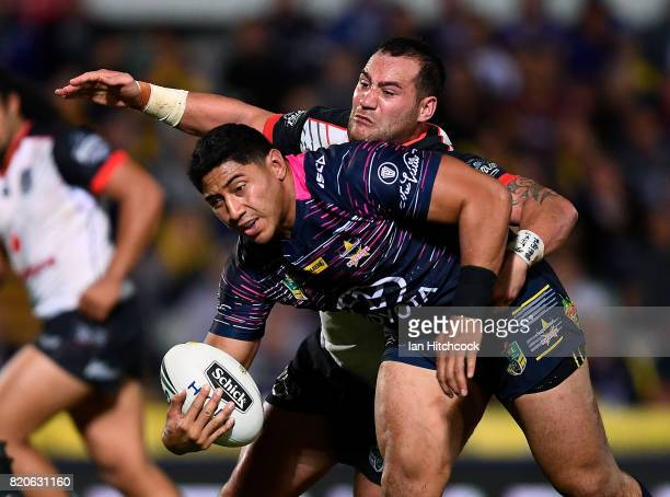 Jason Taumalolo of the Cowboys is tackled by Bodene Thompson of the Warriors during the round 20 NRL match between the North Queensland Cowboys and...