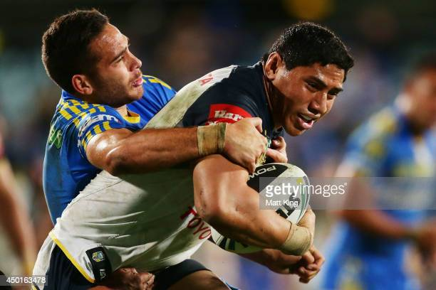 Jason Taumalolo of the Cowboys is tackled by Corey Norman of the Eels during the round 13 NRL match between the Parramatta Eels and the North...