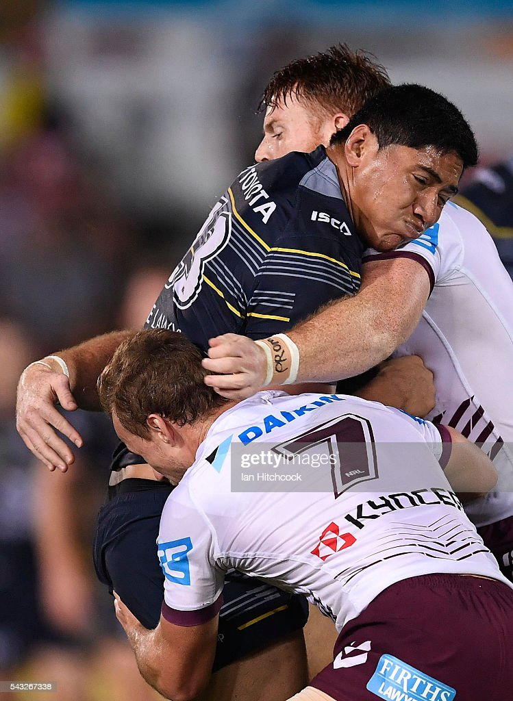Jason Taumalolo of the Cowboys is tackled by Daly Cherry-Evans of the Sea Eagles and Nathan Green of the Sea Eagles during the round 16 NRL match between the North Queensland Cowboys and the Manly Sea Eagles at 1300SMILES Stadium on June 27, 2016 in Townsville, Australia.