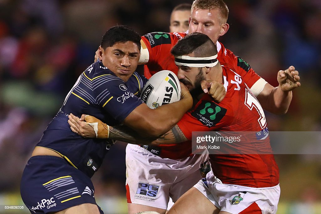 Jason Taumalolo of the Cowboys is tackled by Jacob Marketo of the Dragons during the round 12 NRL match between the St George Illawarra Dragons and the North Queensland Cowboys at WIN Jubilee Stadium on May 28, 2016 in Wollongong, Australia.