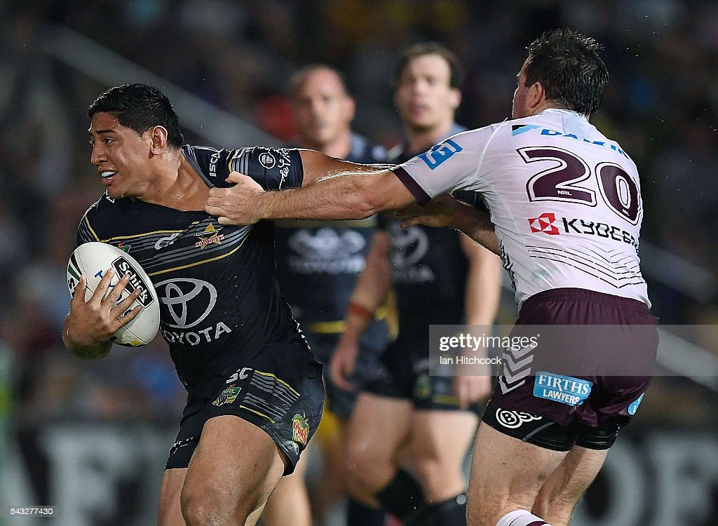 Jason Taumalolo of the Cowboys is tackled by Jamie Lyon of the Sea Eagles during the round 16 NRL match between the North Queensland Cowboys and the Manly Sea Eagles at 1300SMILES Stadium on June 27, 2016 in Townsville, Australia.