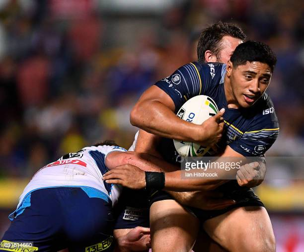 Jason Taumalolo of the Cowboys is tackled by Joe Greenwood of the Titans during the round 13 NRL match between the North Queensland Cowboys and the...
