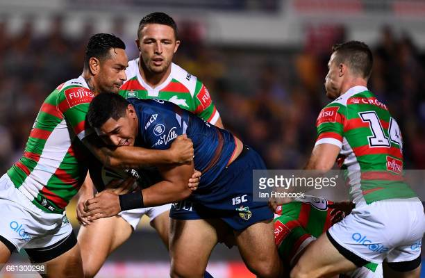 Jason Taumalolo of the Cowboys is tackled by John Sutton of the Rabbitohs during the round five NRL match between the North Queensland Cowboys and...