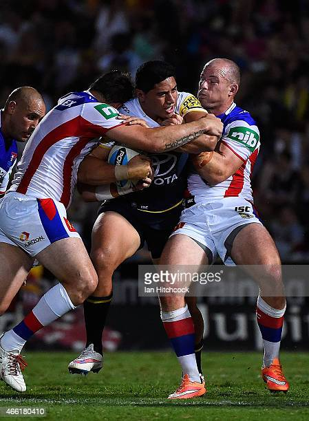 Jason Taumalolo of the Cowboys is tackled by Kade Snowden of the Knights and Beau Scott of the Knights during the round two NRL match between the...