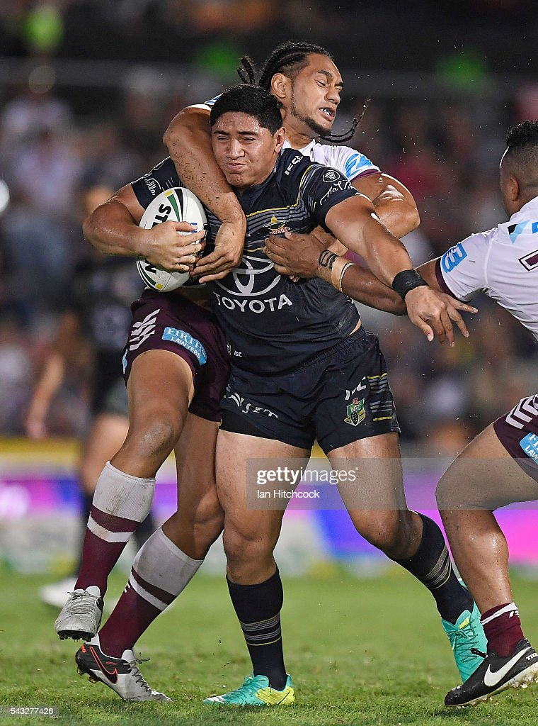 Jason Taumalolo of the Cowboys is tackled by <a gi-track='captionPersonalityLinkClicked' href=/galleries/search?phrase=Martin+Taupau&family=editorial&specificpeople=7988566 ng-click='$event.stopPropagation()'>Martin Taupau</a> of the Sea Eagles during the round 16 NRL match between the North Queensland Cowboys and the Manly Sea Eagles at 1300SMILES Stadium on June 27, 2016 in Townsville, Australia.