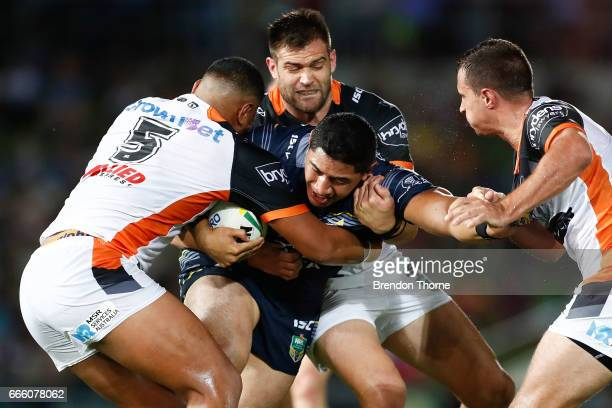 Jason Taumalolo of the Cowboys is tackled by the Tigers defence during the round six NRL match between the North Queensland Cowboys and the Wests...