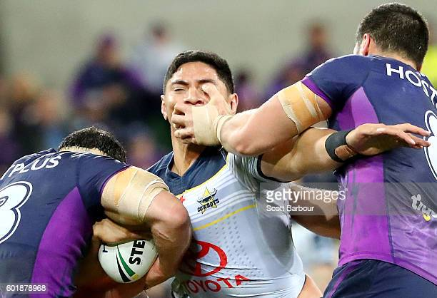 Jason Taumalolo of the Cowboys is tackled during the NRL Qualifying Final match between the Melbourne Storm and the North Queensland Cowboys at AAMI...
