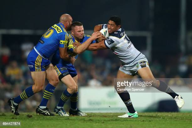 Jason Taumalolo of the Cowboys is tackled during the round 14 NRL match between the Parramatta Eels and the North Queensland Cowboys at TIO Stadium...
