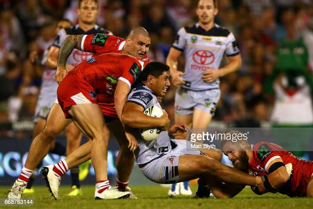 Jason Taumalolo of the Cowboys is tackled during the round seven NRL match between the St George Illawarra Dragons and the North Queensland Cowboys...