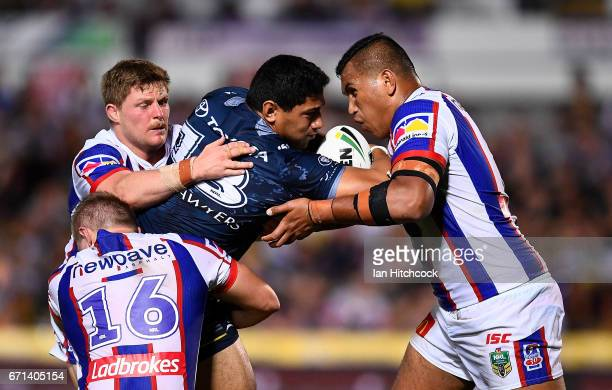 Jason Taumalolo of the Cowboys is wrapped up by the Knigts defence during the round eight NRL match between the North Queensland Cowboys and the...