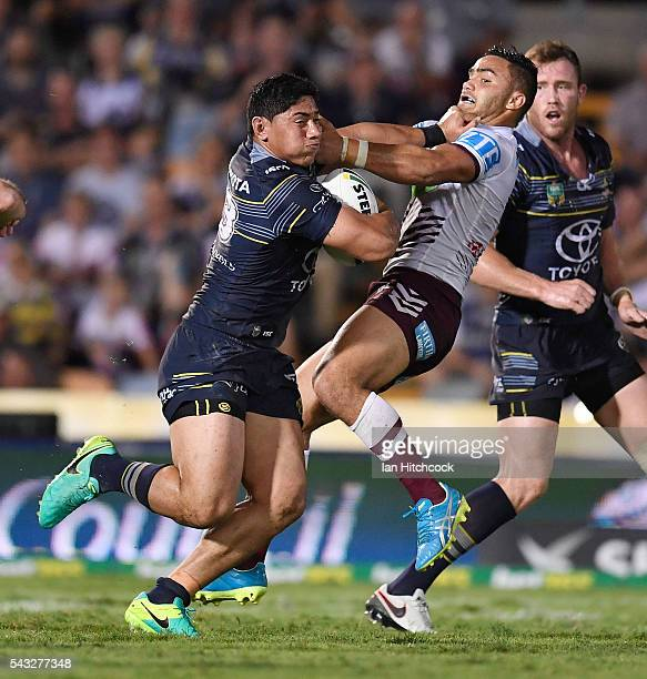 Jason Taumalolo of the Cowboys palms off Dylan Walker of the Sea Eagles during the round 16 NRL match between the North Queensland Cowboys and the...
