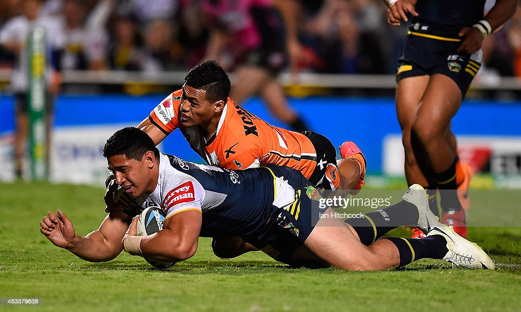 Jason Taumalolo of the Cowboys scores a try during the round 22 NRL match between the North Queensland Cowboys and the Wests Tigers at 1300SMILES Stadium on August 9, 2014 in Townsville, Australia.
