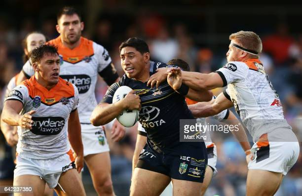 Jason Taumalolo of the Cowboys takes on the defence during the NRL Trial match between the Wests Tigers and the North Queensland Cowboys at...