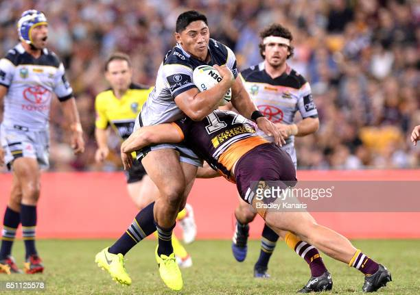 Jason Taumalolo of the Cowboys takes on the defence during the round two NRL match between the Brisbane Broncos and the North Queensland Cowboys at...