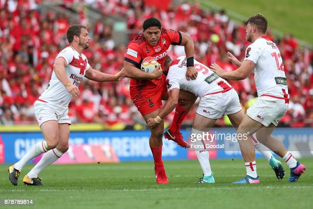 Jason Taumalolo of Tonga is tackled by Josh Hodgson of England during the 2017 Rugby League World Cup Semi Final match between Tonga and England at...