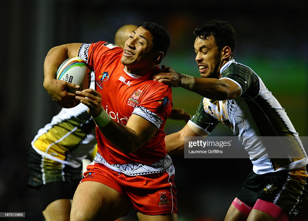 Jason Taumololo of Tonga scores a first half try during the Rugby League World Cup GroupC/D match between Tonga and Cook Islands at Leigh Sports Village on November 5, 2013 in Leigh, Greater Manchester.