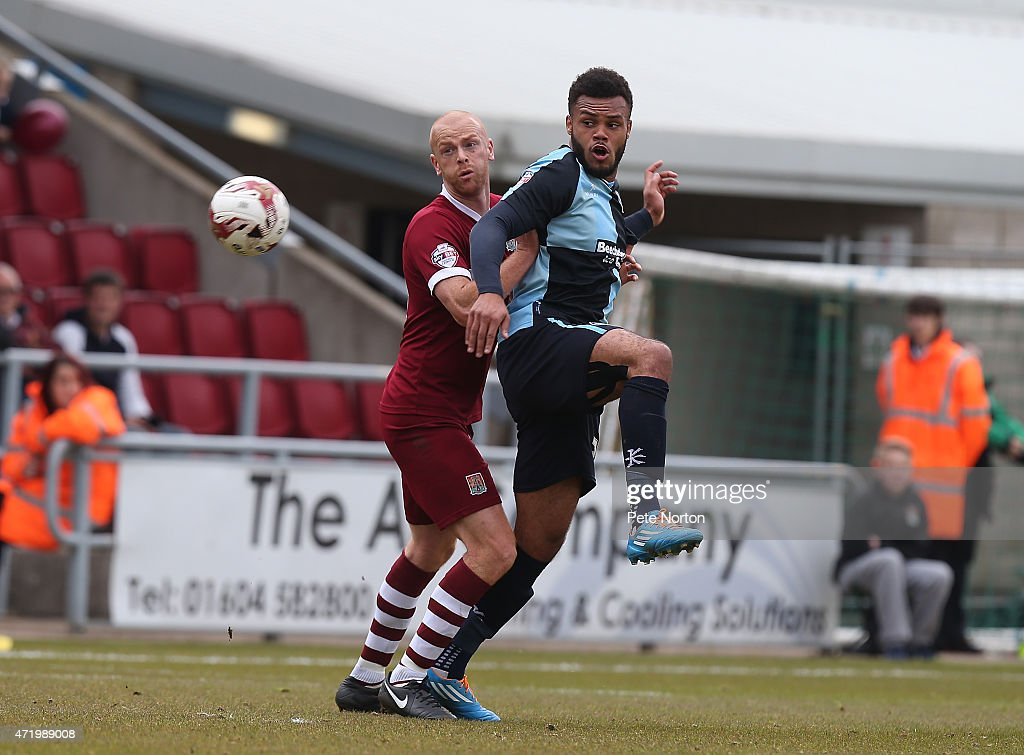 Jason Taylor of Northampton Town looks for the ball with Aaron Holloway of Wycombe Wanderers during the Sky Bet League Two match between Northampton Town and Wycombe Wanderers at Sixfields Stadium on May 2, 2015 in Northampton, England.