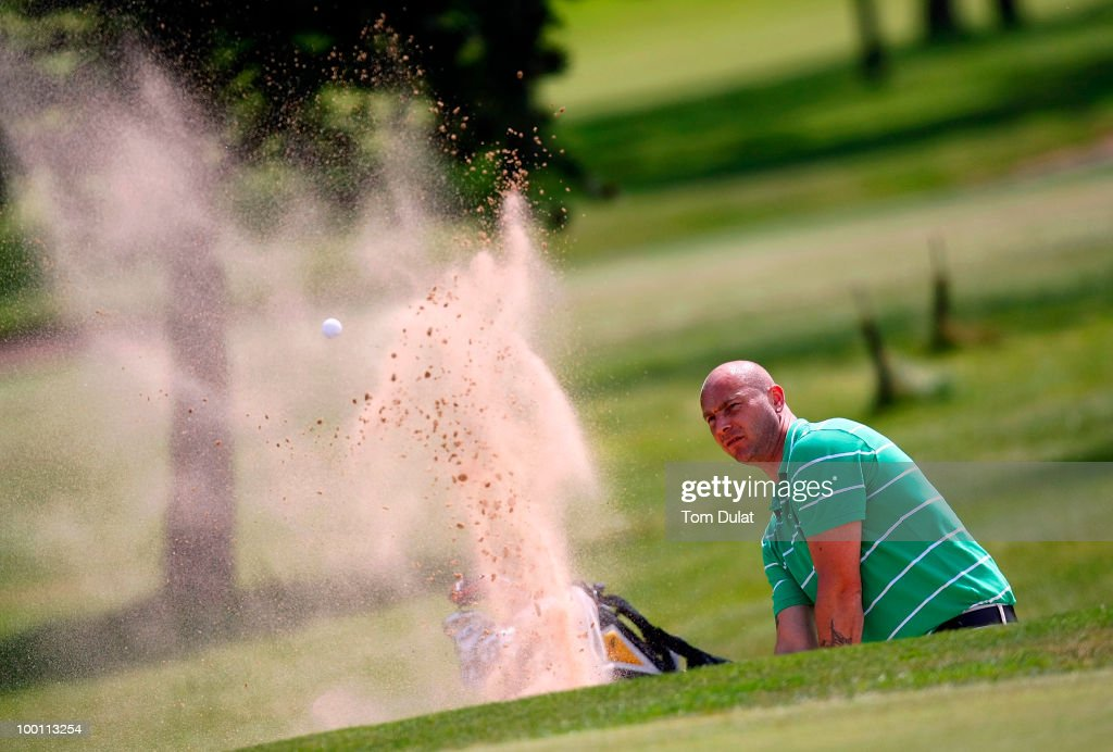 Jason Taylor of Shrigley plays out the bunker on the 7th hole during the Virgin Atlantic PGA National Pro-Am Championship Regional Qualifier at Dunham Forest Golf and Country Club on May 21, 2010 in Manchester, England.