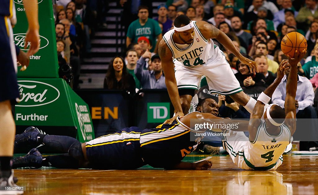 <a gi-track='captionPersonalityLinkClicked' href=/galleries/search?phrase=Jason+Terry&family=editorial&specificpeople=201734 ng-click='$event.stopPropagation()'>Jason Terry</a> #4 and <a gi-track='captionPersonalityLinkClicked' href=/galleries/search?phrase=Chris+Wilcox&family=editorial&specificpeople=202038 ng-click='$event.stopPropagation()'>Chris Wilcox</a> #44 of the Boston Celtics fight for posession of the ball against <a gi-track='captionPersonalityLinkClicked' href=/galleries/search?phrase=Al+Jefferson&family=editorial&specificpeople=201604 ng-click='$event.stopPropagation()'>Al Jefferson</a> #25 of the Utah Jazz during the game on November 14, 2012 at TD Garden in Boston, Massachusetts.