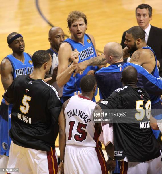 Jason Terry Dirk Nowitzki and Brian Cardinal of the Dallas Mavericks attempt to seperate teammate Tyson Chandler of the Dallas Mavericks and Juwan...
