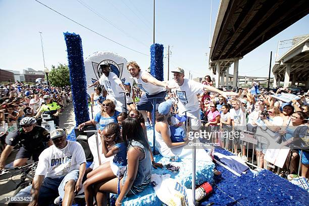 Jason Terry Dirk Nowitzki and Jason Kidd of the Dallas Mavericks greet fans as they ride along during the Mavericks NBA Champion Victory Parade on...