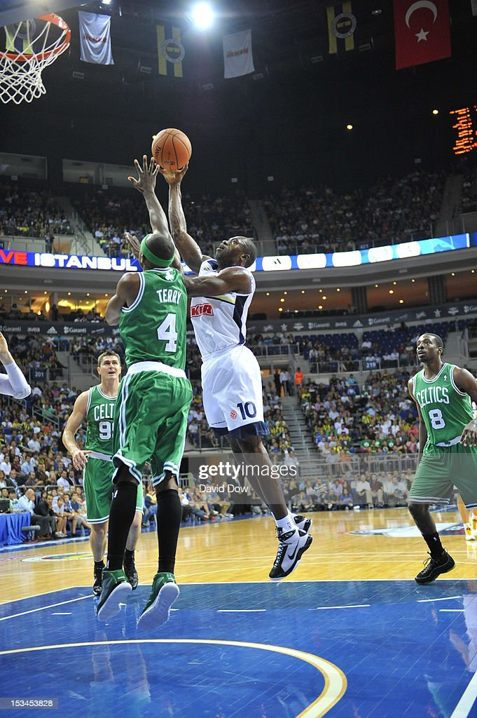 <a gi-track='captionPersonalityLinkClicked' href=/galleries/search?phrase=Jason+Terry&family=editorial&specificpeople=201734 ng-click='$event.stopPropagation()'>Jason Terry</a> #4 of the Boston Celtics attempts to block a shot against Sato Romain #10 of the Fenerbahce Ulker during the NBA Europe Live Tour on October 5, 2012 at the Ulker Sports Arena in Istanbul, Asia.