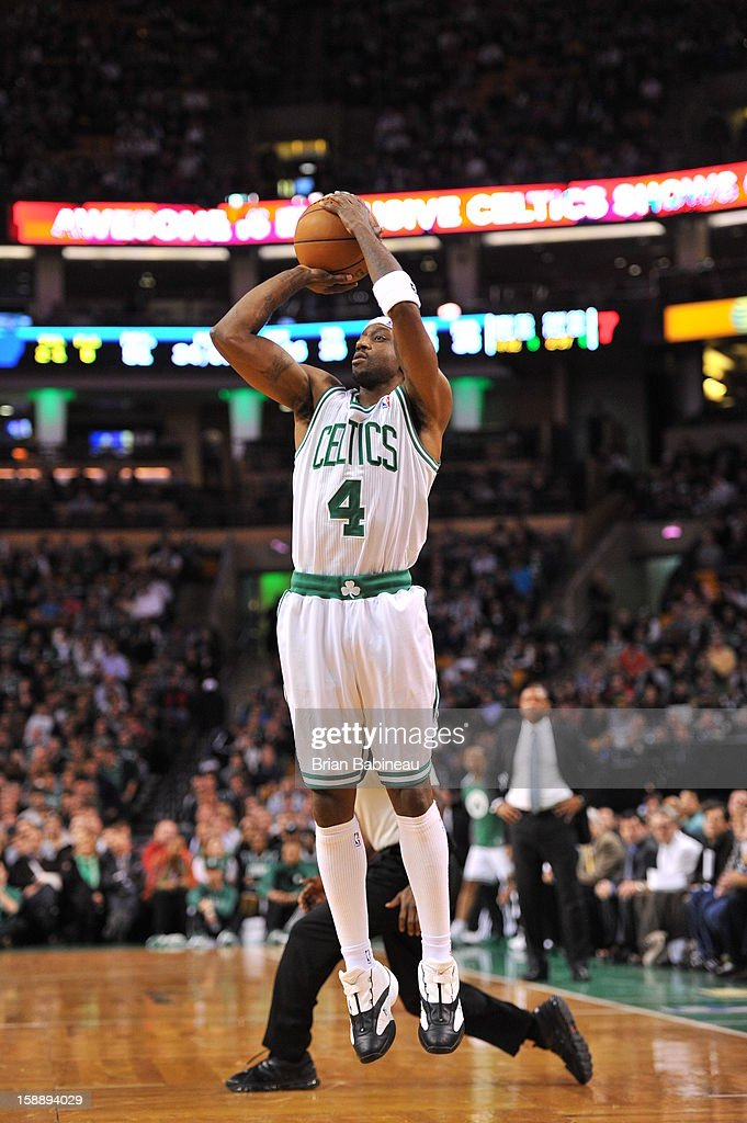 <a gi-track='captionPersonalityLinkClicked' href=/galleries/search?phrase=Jason+Terry&family=editorial&specificpeople=201734 ng-click='$event.stopPropagation()'>Jason Terry</a> #4 of the Boston Celtics shoots a deep shot against the Memphis Grizzlies on January 2, 2013 at the TD Garden in Boston, Massachusetts.