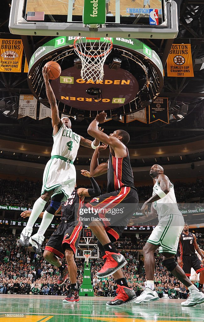 Jason Terry #4 of the Boston Celtics shoots a layup against Chris Bosh #1 of the Miami Heat on January 27, 2013 at the TD Garden in Boston, Massachusetts.