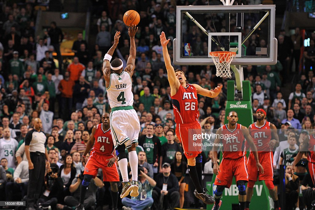 <a gi-track='captionPersonalityLinkClicked' href=/galleries/search?phrase=Jason+Terry&family=editorial&specificpeople=201734 ng-click='$event.stopPropagation()'>Jason Terry</a> #4 of the Boston Celtics shoots to win the game against the Atlanta Hawks on March 8, 2013 at the TD Garden in Boston, Massachusetts.