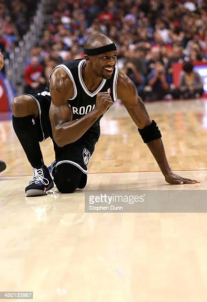 Jason Terry of the Brooklyn Nets pumps his fist as he celebrates towards his bench after making a basket and picking up a foul against the Los...