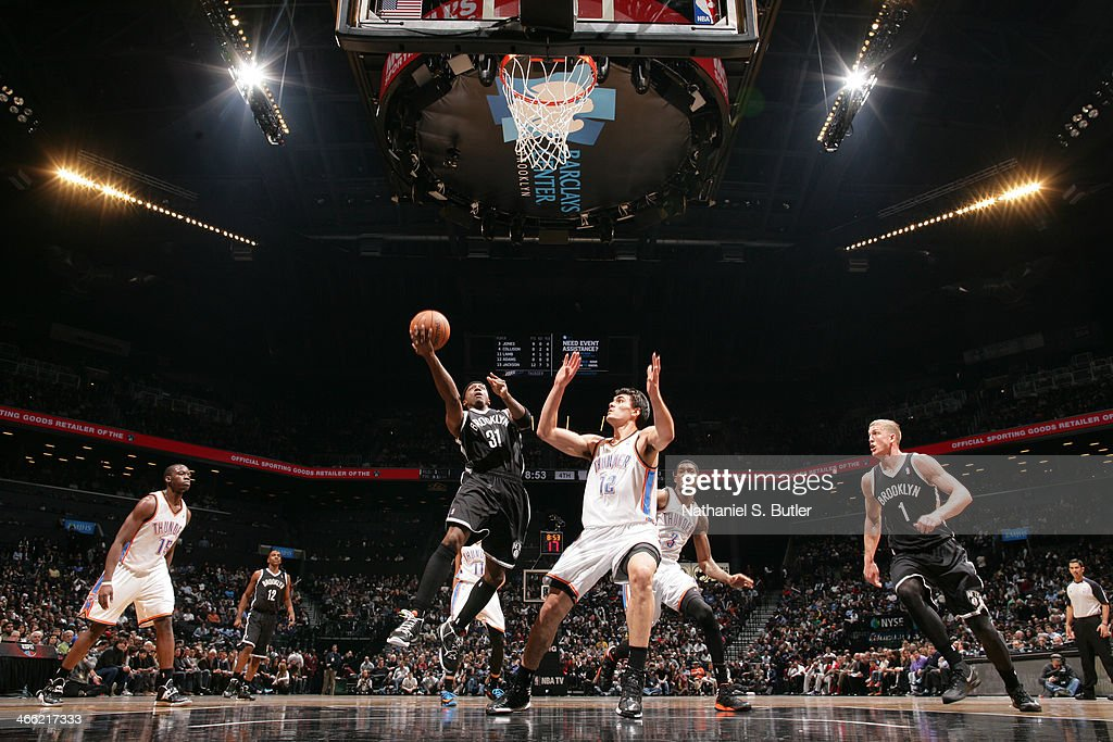 <a gi-track='captionPersonalityLinkClicked' href=/galleries/search?phrase=Jason+Terry&family=editorial&specificpeople=201734 ng-click='$event.stopPropagation()'>Jason Terry</a> #31 of the Brooklyn Nets shoots against Steven Adams #12 of the Oklahoma City Thunder at the Barclays Center on January 31, 2014 in the Brooklyn borough of New York City.