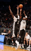 Jason Terry of the Brooklyn Nets shoots against Tyshawn Taylor of the Brooklyn Nets during an Open Practice at the Barclays Center on October 20 2013...
