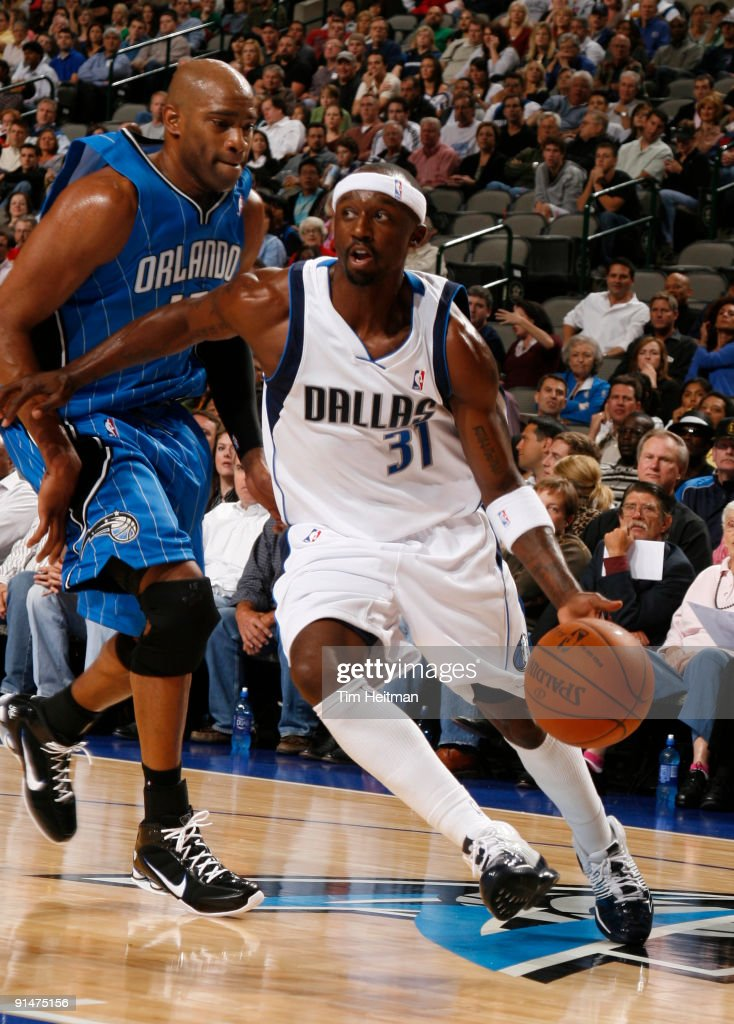Jason Terry of the Dallas Mavericks drives against Vince Carter of the Orlando Magic in preseason action at the American Airlines Center on October 5...