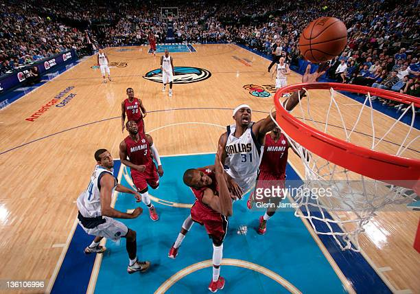 Jason Terry of the Dallas Mavericks goes in for the layup against James Jones of the Miami Heat on December 25 2011 at the American Airlines Center...