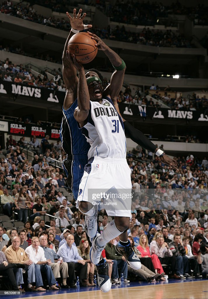 Jason Terry #31 of the Dallas Mavericks goes up for the layup against Mickael Pietrus #20 of the Orlando Magic during a game at the American Airlines Center on April 1, 2010 in Dallas, Texas.