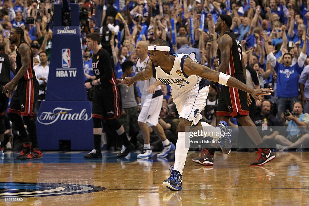 Jason Terry #31 of the Dallas Mavericks reacts after he made a 3-point shot late in the fourth quarter as Udonis Haslem #40 (L), Mike Miller #13 and LeBron James #6 of the Miami Heat walk towards their bench in Game Five of the 2011 NBA Finals at American Airlines Center on June 9, 2011 in Dallas, Texas.