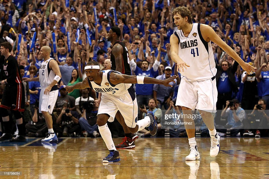 <a gi-track='captionPersonalityLinkClicked' href=/galleries/search?phrase=Jason+Terry&family=editorial&specificpeople=201734 ng-click='$event.stopPropagation()'>Jason Terry</a> #31 of the Dallas Mavericks reacts after he made a three-pointer late in the fourth quarter alongside teammate <a gi-track='captionPersonalityLinkClicked' href=/galleries/search?phrase=Dirk+Nowitzki&family=editorial&specificpeople=201490 ng-click='$event.stopPropagation()'>Dirk Nowitzki</a> #41 while taking on the Miami Heat in Game Five of the 2011 NBA Finals at American Airlines Center on June 9, 2011 in Dallas, Texas.