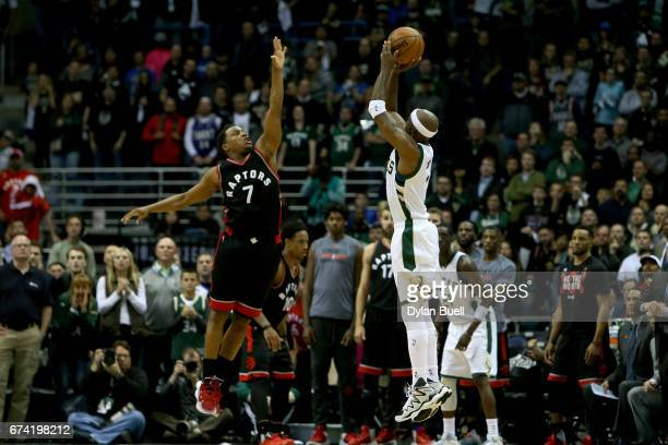 Jason Terry of the Milwaukee Bucks attempts a shot over Kyle Lowry of the Toronto Raptors in the fourth quarter in Game Six of the Eastern Conference...