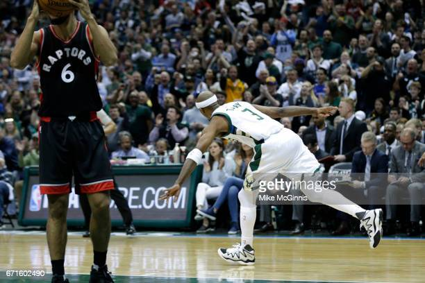 Jason Terry of the Milwaukee Bucks celebrates after stealing the basketball from DeMar DeRozan of the Toronto Raptors defending during the first half...