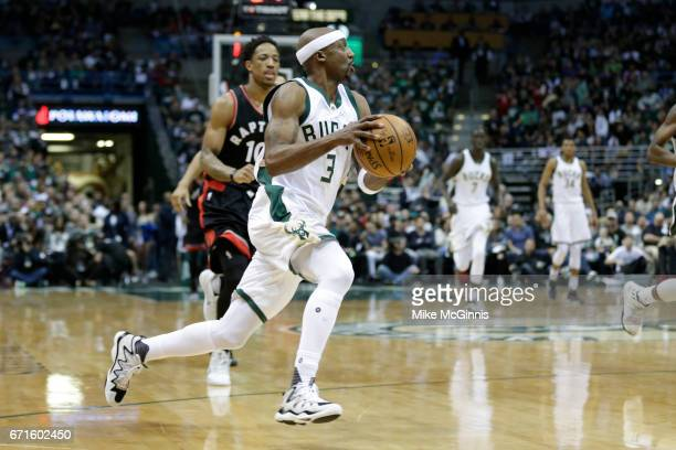 Jason Terry of the Milwaukee Bucks dribbles the up the court after stealing the basketball from DeMar DeRozan of the Toronto Raptors defending during...