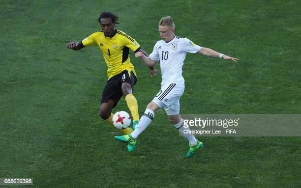 Jason Thomas of Vanuatu battles with Philipp Ochs of Germany during the FIFA U20 World Cup Korea Republic 2017 group B match between Germany and...