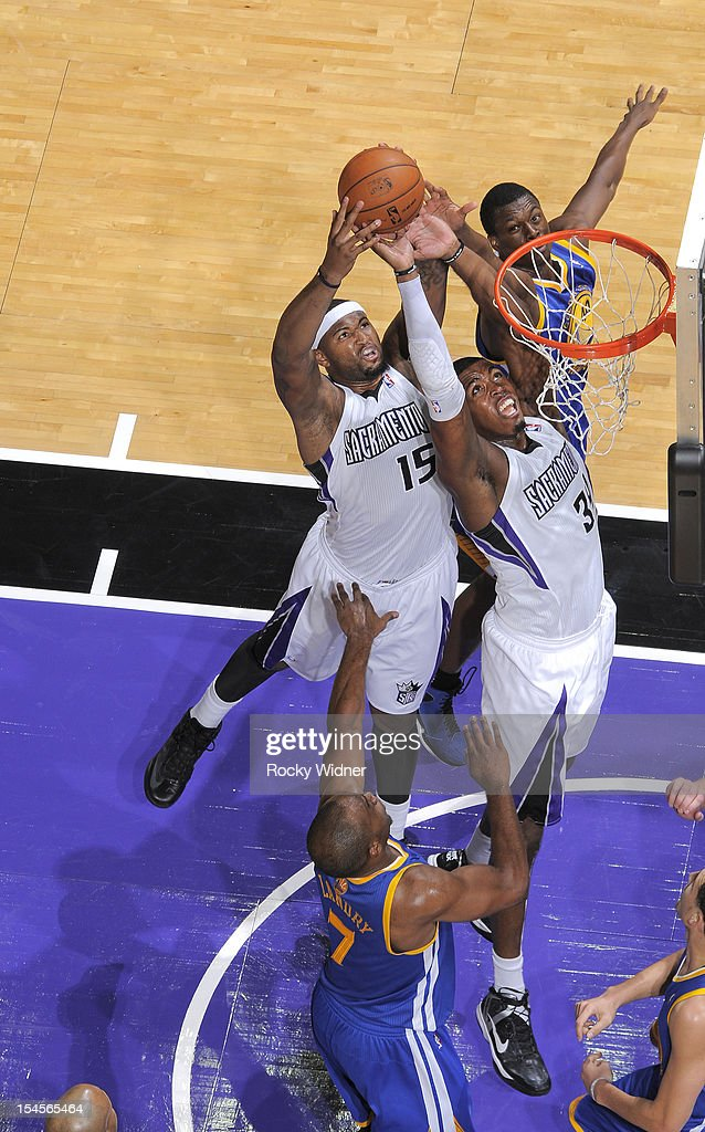 Jason Thompson #34 and DeMarcus Cousins #15 of the Sacramento Kings collaborate for the rebound against the Golden State Warriors on October 17, 2012 at Power Balance Pavilion in Sacramento, California.