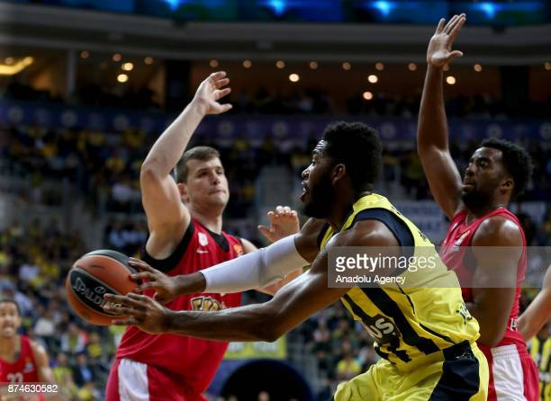 Jason Thompson of Fenerbahce Dogus in action against Dimitrios Agravanis of Olympiacos during the Turkish Airlines Euroleague basketball match...